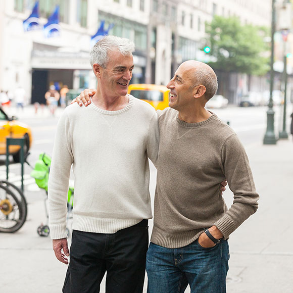 Same-sex couple covered by a Medicare supplement plan walking down a street