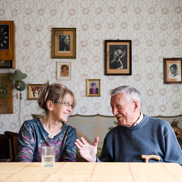 Man and woman discussing life insurance policies