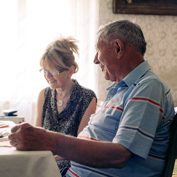 Smiling couple discussing life insurance needs